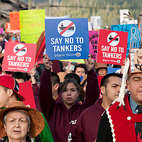 Pipeline and tanker protest. Prince Rupert British Columbia, Canada.  The proposed  Northern Gateway Pipeline would pump tar sands crude 1200 km. across northern Alberta and B.C. to the port of Kitimaat where it would be shipped to China. The pipeline passes though some of the most rugged and remote areas of Canada and crosses hundreds of productive salmon streams. A spill along this route would have major environmental impacts. Of even greater concern, massive oil tankers would take the crude oil through some of the world's most difficult to navigate waters. The coastal First Nations realize the risks and that the almost certain ecological impacts would be the end of   the ecological integrity of the marine environment which is the foundation for both their culture and economy.    Nikon D300, Nikkor 70-200mm f2.8 shat at 200mm, ISO 400, 1/200 at f10.