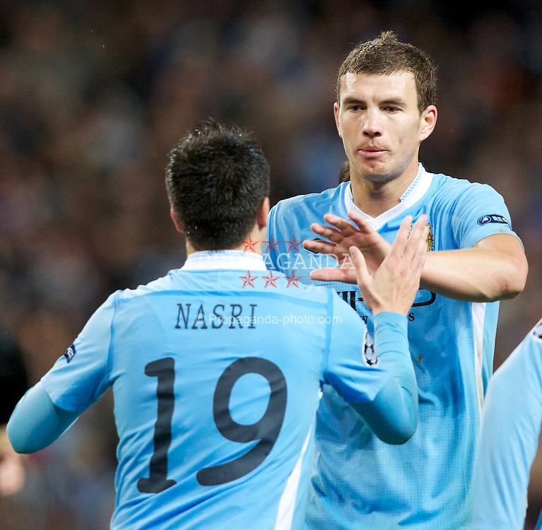 MANCHESTER, ENGLAND - Tuesday, Octover 18, 2011: Manchester City's Edin Dzeko celebrates his side's 1-1 goal with team-mate Samir Nasri against Villarreal CF during the UEFA Champions League Group A match at the City of Manchester Stadium. (Pic by Vegard Grott/Propaganda)