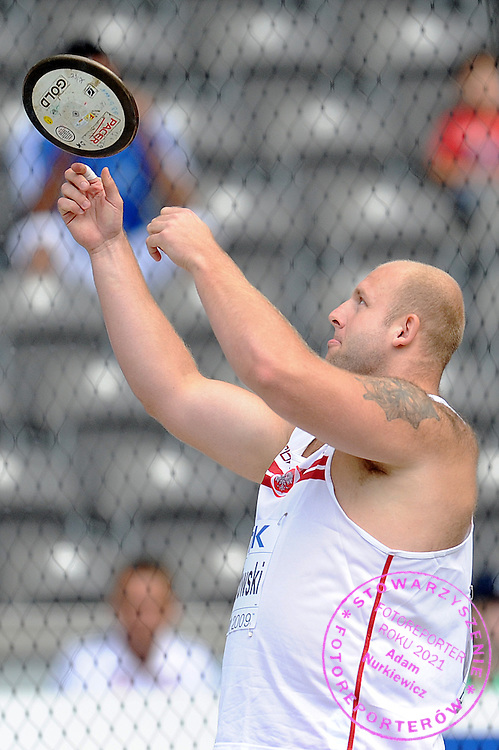 PIOTR MALACHOWSKI (POLAND) COMPETES IN DISCUS MEN QUALIFICATION ON THE OLYMPIC STADION ( OLIMPIASTADION ) DURING 12TH IAAF WORLD CHAMPIONSHIPS IN ATHLETICS BERLIN 2009..BERLIN , GERMANY , AUGUST 18, 2009..( PHOTO BY ADAM NURKIEWICZ / MEDIASPORT )..PICTURE ALSO AVAIBLE IN RAW OR TIFF FORMAT ON SPECIAL REQUEST.
