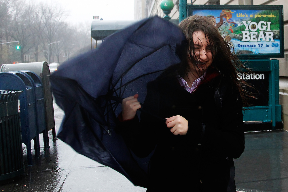 A girl fighting the winds on West 86th street on December 1, 2010 in  New York City.Photo by: Joe Kohen for The Wall Street Journal.