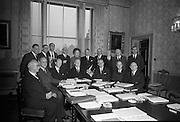 Meeting of the Council of State convened at Áras an Uachtaráin by President Eamon de Valera..(l-r front row) .Cathorlaigh Sheanad Eireann-Liam Ua O'Buachalla;.Tanaiste agus Aire Gnotha Eachtacta-Prionsias MacAogain;.An Taoiseach- Sean O Loinsigh;.An tUachtarain-Eamon de Valera;.Acting Clerk of the Council-M. O'Slataraigh;.An Priomh-Bhraitheamh-An Saoi Onorach Cearbhaill O'Dalaigh;.Uachtaran na hArd-Chuirte-An Braitheamh Onorach Aindrias O Caoimh;.(standing).Deputy Seán Lemass;.Dr. Robert Briscoe;.Deputy Brendan Cornish;.Deputy James M. Dillon;.Mrs. Jane Dowdall;.Deputy Maurice E. Dockerall;.An Saoi Onorach Conchubhar Maguidhir;.An Ginearal Risteard Ua Maolchatha;.Deputy J.A. Costello;.An tArd-Aighna Colm Condun..06.03.1967