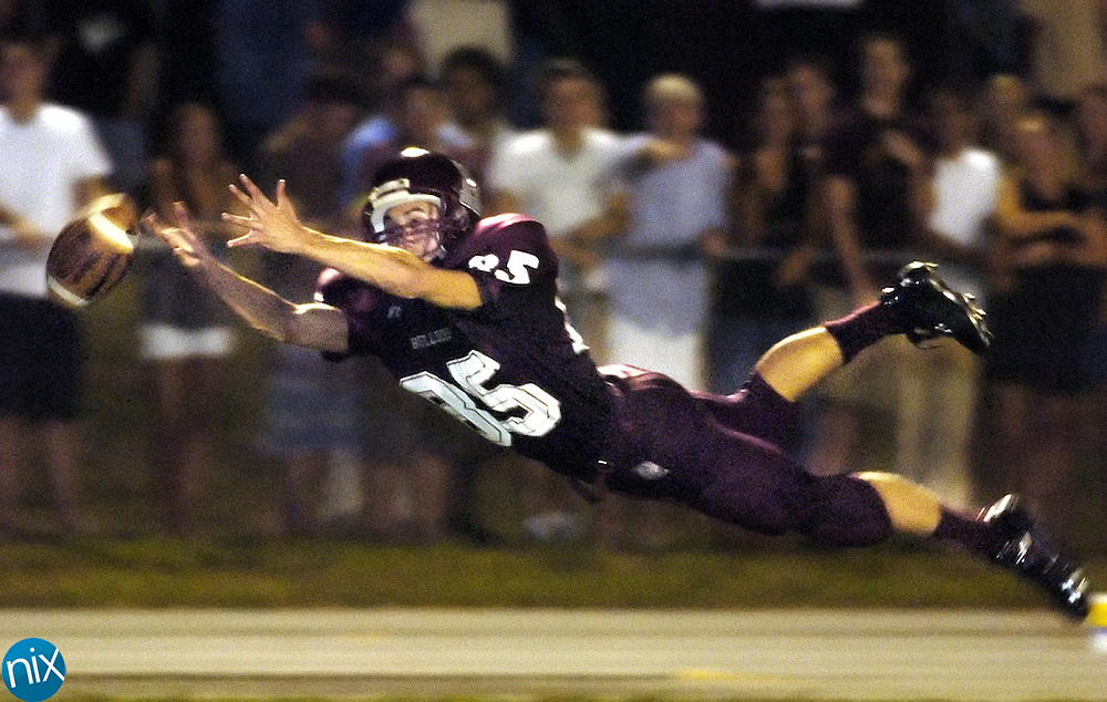 Robinson's Cyrus Mojtabai dives for a football just out of reach in the endzone against Concord High School Friday night.