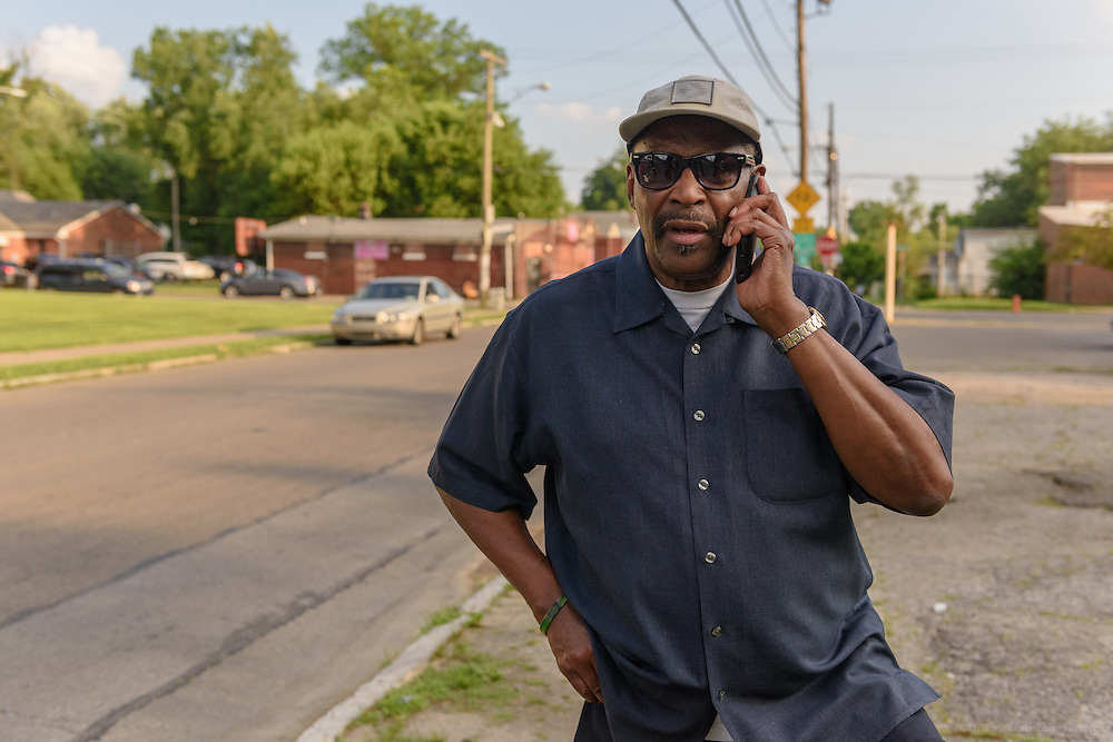 Eddie Woods, director of Street Peace: No More Red Dots, calls Norman Martin, his childhood friend and Street Peace's team coordinator, Monday, June 20, 2016 on 32nd Street in the Parkland neighborhood. (Photo by Brian Bohannon)