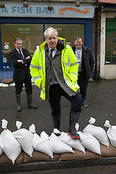 Mayor of London Boris Johnson poses next to sand bags during a visit to Kenley water treatment centre,  Kenley, Croydon, United Kingdom, Tuesday, 11th February 2014. Picture by Daniel Leal-Olivas / i-Images