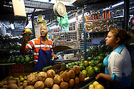 Venezuelan citizens stand on a vegetables stand at the Quinta Crespo market in Caracas (Venezuela) Feb. 3, 2009 (Photo/Ivan Gonzalez)