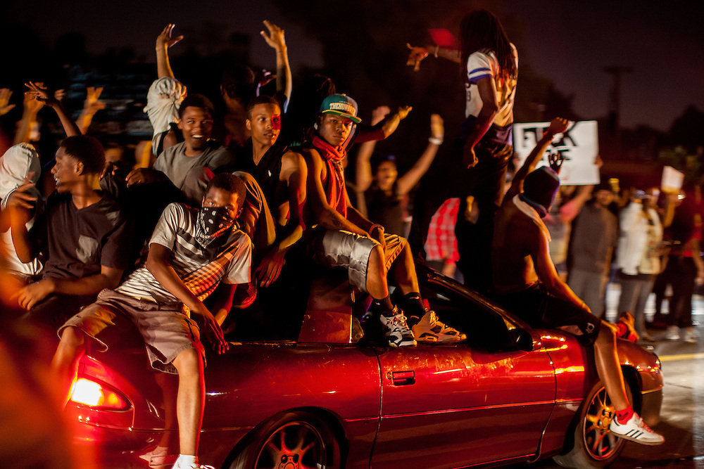 Demonstrators pile into cars and cruise up and down West Florissant Avenue, honking there horns and blasting music. Protests have been ongoing in Ferguson, Missouri since the shooting death of Michael Brown, the eighteen-year-old unarmed teen killed by police on August 9, 2014.