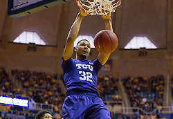 Jan 7, 2017; Morgantown, WV, USA; TCU Horned Frogs forward Karviar Shepherd (32) dunks the ball during the first half against the West Virginia Mountaineers at WVU Coliseum. Mandatory Credit: Ben Queen-USA TODAY Sports