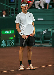 April 13, 2018 - Houston, TX, U.S. - HOUSTON, TX - APRIL 13:  Taylor Fritz of the United States jokes about getting his racket wet in the match against Jack Sock of the United States during the Quarterfinal round of the Men's Clay Court Championship on April 13, 2018 at River Oaks Country Club in Houston, Texas.  (Photo by Leslie Plaza Johnson/Icon Sportswire) (Credit Image: © Leslie Plaza Johnson/Icon SMI via ZUMA Press)