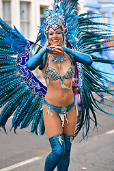 **CAPTION CORRECTION, pictures taken TODAY 29/08/2016**© Licensed to London News Pictures. 29/08/2016. London, UK. Carnival goers enjoy day two of the Notting Hill carnival, the second largest street festival in the world after the Rio Carnival in Brazil, attracting over 1 million people to the streets of West London.  Photo credit: Ben Cawthra/LNP