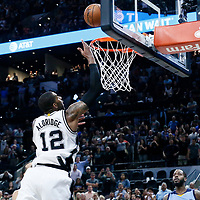 04 April 2017: San Antonio Spurs forward LaMarcus Aldridge (12) goes for the alley-oop to tie the game at the end of regulation during the San Antonio Spurs 95-89 OT victory over the Memphis Grizzlies, at the AT&T Center, San Antonio, Texas, USA.