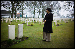 Baroness Sayeeda Warsi looking at the graves of Chinese and Hindu Soldiers at the Lijssenthoek Military Cemetery in Belgium. Sayeeda is visiting the graves of Commonwealth soldiers on the battlefields of France and Belgium as part of the UK Government's programme to commemorate the centenary of the First World War which starts next year, Wednesday  April 10, 2013. Photo By Andrew Parsons / i-Images