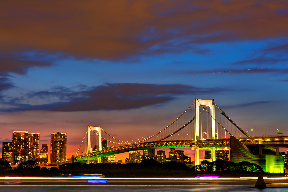 Rainbow Bridge connects Odaiba, a large artificial island, and Central Tokyo across Tokyo Bay. It is a large multi-purpose suspension bridge. It uses solar powered modern lighting techniques to colorfully light the bridge.
