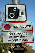 Road signs for speed camera and red route no stopping at any time, Embankment, London