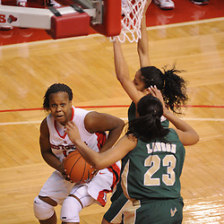 Jan 31, 2009; Piscataway, NJ, USA; Rutgers guard Epiphanny Prince (10) battles for a shot against South Florida center Jessica Lawson (23) and guard Jazmine Sepulveda (4) during the second half of South Florida's 59-56 victory over Rutgers in NCAA women's college basketball at the Louis Brown Athletic Center
