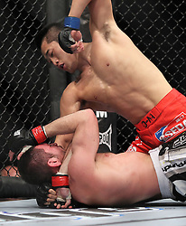 May 29, 2010; Las Vegas, NV; USA;  Amir Sadollah (black trunks) and Dong Hyun Kim (red trunks) fight during their bout at UFC 114 at the MGM Grand Garden Arena in Las Vegas.