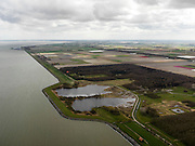 Nederland, Noord-Holland, Gemeente Wieringermeer, 16-04-2012. Wieringermeer met Dijkgatbos met Noordelijk en Zijdelijk Wiel. De wielen zijn restant van doorbraak dijk in 1945 (wraakactie Duitse bezettingstroepen).Wieringmeer polder,  newly created land 1927, part of the Zuiderzee Works. The wheels are remaind of a dike breach caused in 1945 (retaliation German occupation troops)..luchtfoto (toeslag), aerial photo (additional fee required);.copyright foto/photo Siebe Swart
