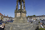 People are sitting in Helmsley's town square, Yorkshire, England, United Kingdom.