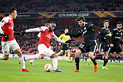 Arsenal's Alexandre Lacazette (9) opens the scoring during the Europa League group stage match between Arsenal and FK QARABAG at the Emirates Stadium, London, England on 13 December 2018.