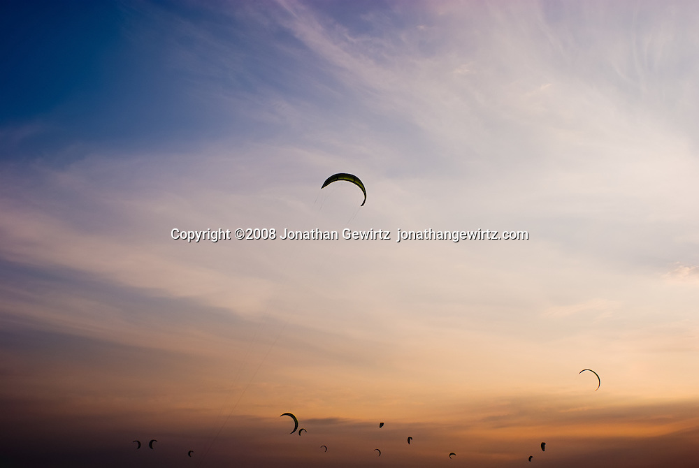 Kitesurfers' sails appear to float in the twilight at Hobie Beach on Virginia Key near Miami, Florida. WATERMARKS WILL NOT APPEAR ON PRINTS OR LICENSED IMAGES.