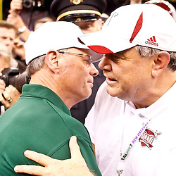 December 18, 2010; New Orleans, LA, USA; Troy Trojans head coach Larry Blakeney and Ohio Bobcats head coach Frank Solich meet following end of the 2010 New Orleans Bowl at the Louisiana Superdome. Troy defeated Ohio 48-21. Mandatory Credit: Derick E. Hingle