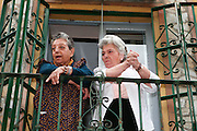 Sevilla, Spain. April 12th 2006..Two women watch a procession from their balcony during the Holy Week.