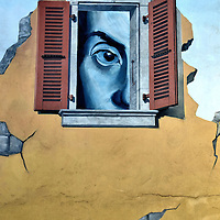 Large Face Looking Out Window Mural in Nyon, Switzerland<br />