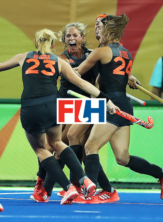 RIO DE JANEIRO, BRAZIL - AUGUST 19: Kitty van Male of the Netherlands celebrates scoring during the Women's Hockey final between Great Britain and the Netherlands on day 14 at Olympic Hockey Centre on August 19, 2016 in Rio de Janeiro, Brazil. (Photo by Ian MacNicol/Getty Images)