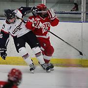 Nora Maclaine, (left), UConn and Sammy Davis, Boston University, clash during the UConn Vs Boston University, Women's Ice Hockey game at Mark Edward Freitas Ice Forum, Storrs, Connecticut, USA. 5th December 2015. Photo Tim Clayton