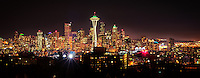 The city of Seattle, beautifully lit on a cold winter night.