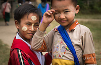 INLE LAKE, MYANMAR - CIRCA DECEMBER 2013: Burmese kids in the Sankar village (or Samka ). A small village located in the south of Inle Lake.