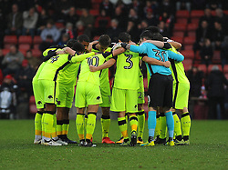 Exeter City players huddle together before kick-off - Mandatory by-line: Nizaam Jones/JMP- 10/12/2016 - FOOTBALL - LCI Rail Stadium - Cheltenham, England - Cheltenham Town v Exeter City - Sky Bet League Two