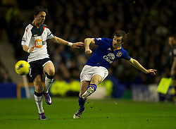 LIVERPOOL, ENGLAND - Wednesday, January 4, 2012: Everton's Leighton Baines in action against Bolton Wanderers' Chris Eagles during the Premiership match at Goodison Park. (Pic by David Rawcliffe/Propaganda)