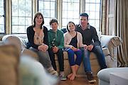The Baker family in their living room. From left to right: Susannah Baker, Zac Baker (11), Liza Baker (9), Steve Baker. Pickwell Manor, Georgeham, North Devon, UK.<br /> CREDIT: Vanessa Berberian for The Wall Street Journal<br /> HOUSESHARE