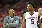 FAYETTEVILLE, AR - NOVEMBER 13:  Head Coach Mike Anderson talks with Anthlon Bell #5 of the Arkansas Razorbacks during a game against the Southern University Jaguars at Bud Walton Arena on November 13, 2015 in Fayetteville, Arkansas.  The Razorbacks defeated the Jaguars 86-68.  (Photo by Wesley Hitt/Getty Images) *** Local Caption *** Mike Anderson; Anthlon Bell
