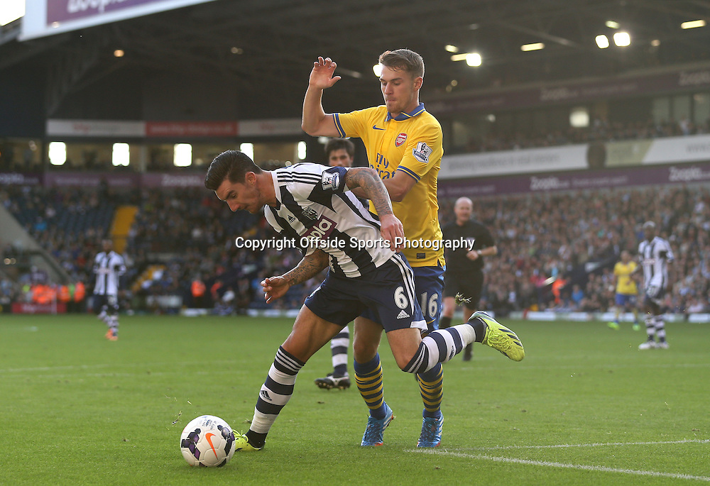 6th October 2013 - Barclays Premier League - West Bromwich Albion v Arsenal - Aaron Ramsey of Arsenal challenges Liam Ridgewell of West Brom - Photo: Simon Stacpoole / Offside.