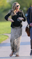 Pregnant model Abbey Clancy wearing a black cardigan, black top, pattern maxi skirt a pair of flip flops enjoying the sunshine at a park in north London, UK. 14/04/2015<br />BYLINE MUST READ : JAMESY/GOTCHA IMAGES<br /><br />Copyright by © Gotcha Images Ltd. All rights reserved.<br />Usage of this image is conditional upon the acceptance <br />of Gotcha Images Ltd, terms and conditions available at<br />www.gotchaimages.com