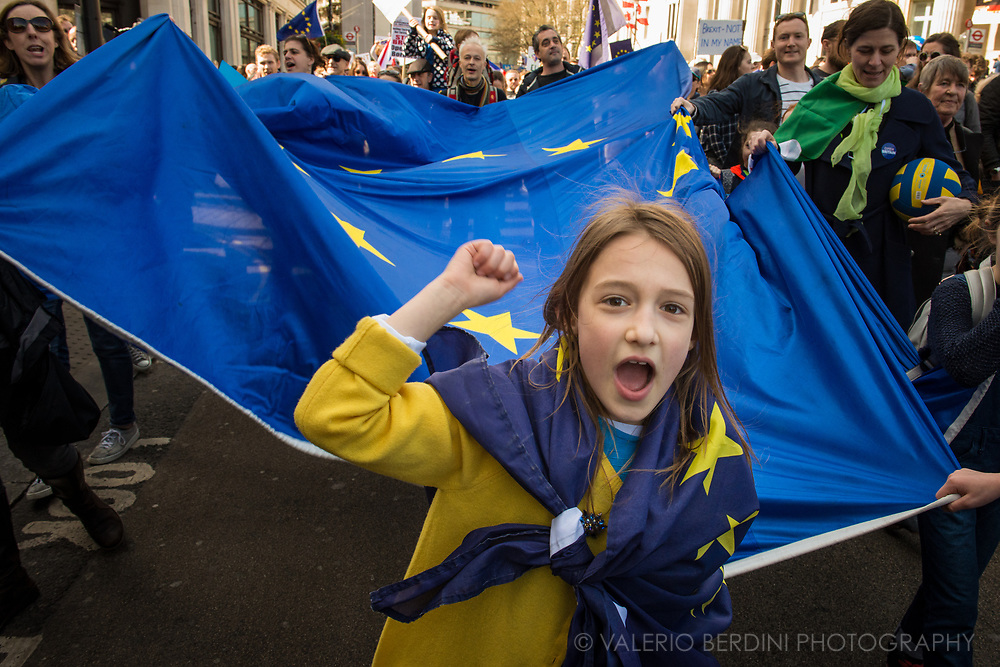 Young supporter of UK in the EU march pass Trafalgar Square