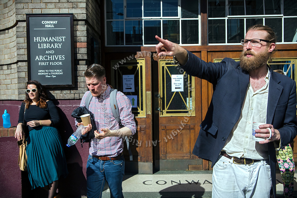 After the congregation, Sanderson Jones (centre/right) is talking to a person who has just attended to The Sunday Assembly (today held inside Conway Hall in central London), an atheist service founded by British comedians Sanderson Jones and Pippa Evans in 2013, in London, England. The gathering is designed to bring together non-religious people who want a similar communal experience to a religious church. Satellite assemblies have been established in over 30 cities including New York, San Diego, and Dublin.