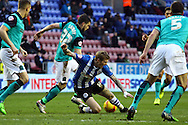 James McClean of Wigan Athletic takes a tumble under pressure from Craig Conway of Blackburn Rovers. Skybet football league championship match , Wigan Athletic v Blackburn Rovers at the DW Stadium in Wigan, Lancs on Saturday 17th Jan 2015.<br /> pic by Chris Stading, Andrew Orchard sports photography.