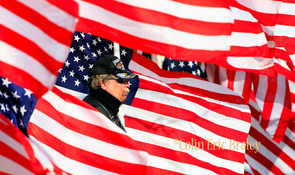 Veteran, Walter Matjasich, a member of the motorcycle club, The Patriot Guard, stands watch during the funeral of U.S. Army Pfc. Aaron Nemelka, Saturday,  Nov. 14, 2009 in West Jordan, Utah. Nemelka was one of 13 gunned down at Fort Hood, Texas. (AP Photo/Colin Braley)