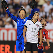 Alex Morgan, USA, and goalkeeper Kim Jungmi, Korea Republic, in action during the U.S. Women Vs Korea Republic friendly soccer match at Red Bull Arena, Harrison, New Jersey. USA. 20th June 2013. Photo Tim Clayton