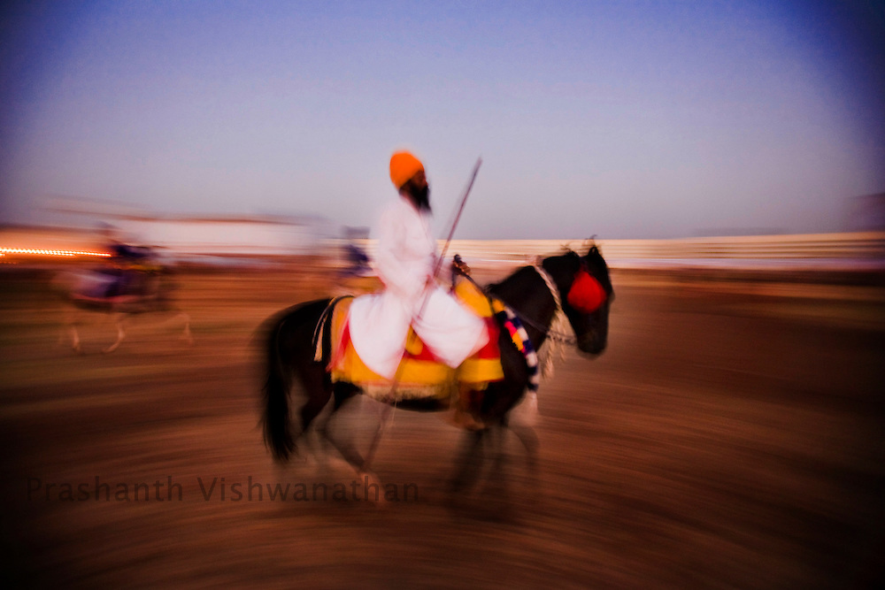 Nihang or sikh religious soldier rides a horse on the second day of the Khalsa festival celebration in Nanded, 650 kms south of Mumbai on November 1, 2008. Once warriors the Nihangsinghs are a clan of army who protected the Sikh Guru's against war and enemies 300 years ago.