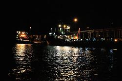 Ships docked at night at Broome Port.