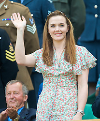 LONDON, ENGLAND - Saturday, June 27, 2009: Olympic cyclist Victoria Pendleton waves to the centre court crowd from the Royal Box during day six of the Wimbledon Lawn Tennis Championships at the All England Lawn Tennis and Croquet Club. (Pic by David Rawcliffe/Propaganda)