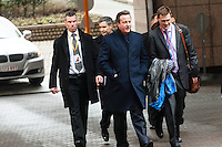 British Prime Minister David Cameron, center, arrives at a EU Budget summit at the European Council building after a break in Brussels, Friday, Feb. 8, 2013. A European Union summit to decide EU spending for the next seven years entered a second day after all-night negotiations left a standoff over spending unresolved. The leaders of the 27 nations inched toward a compromise Friday that would leave their common budget with a real-term cut for the first time in the EU's history.