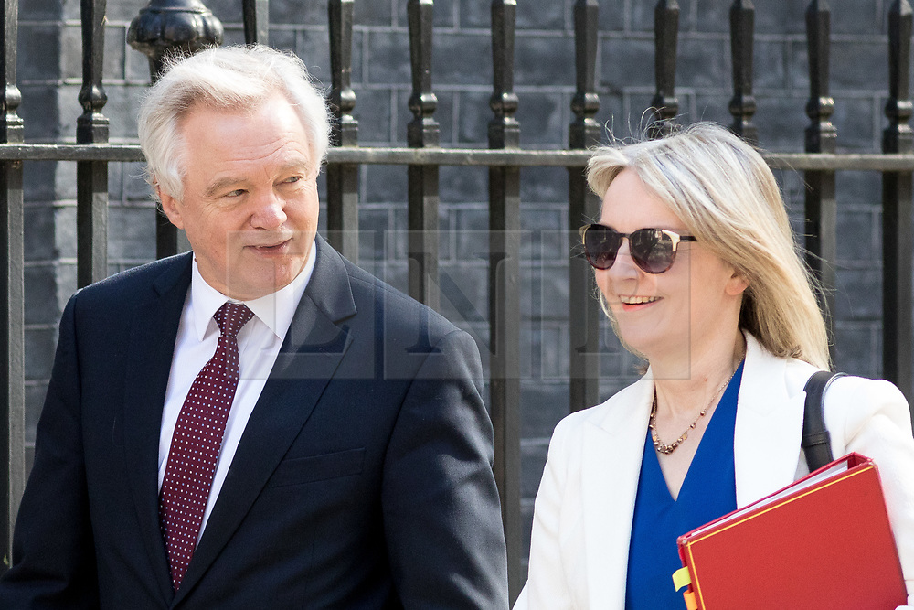 © Licensed to London News Pictures. 01/05/2018. London, UK. Secretary of State for Exiting the European Union David Davis and Chief Secretary to the Treasury Liz Truss arriving in Downing Street to attend a Cabinet meeting this morning. Cabinet positions have recently shuffled around, following Amber Rudd's resignation as Home Secretary, following the Windrush scandal. Photo credit : Tom Nicholson/LNP