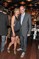 JONNY LEE MILLER and JEMIMA FRENCH at a dinner to celebrate the beginning of a unique partnership between The Naked Heart Foundation and W's Newest Hotel W St.Petersburg -The 'For Russia With Love' dinner was hosted by Sadie Frost and Natalia Vodianova at Spice Market restaurant, W London, Leicester Square, London on 2nd June 2011.