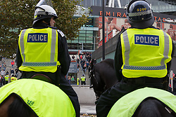 London, November 6th 2016. Mounted police watch as football fans leave the Emirates Stadium after the North London Derby between Arsenal FC and Tottenham Hotspur, that ended in a 1-1 draw.
