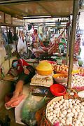 Phnom Penh, Cambodia. Central Market. Nap in a hammock.