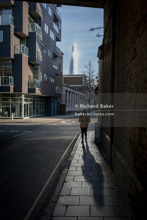 Sunlight reflects off the top of the Shard and across a Southwark street, on 30th January 2018, in London, England.